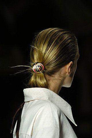Hair, Ear, Hairstyle, Shoulder, Earrings, Mammal, Style, Neck, Back, Brown hair,