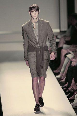 Clothing, Footwear, Leg, Fashion show, Runway, Shoulder, Joint, Outerwear, Human leg, Fashion model,
