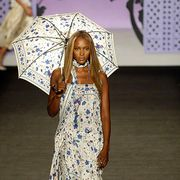Umbrella, Dress, Fashion, Street fashion, Fashion model, Day dress, One-piece garment, Fashion design, Costume design, Makeover,