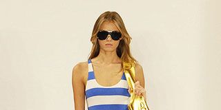 Clothing, Eyewear, Vision care, Brown, Sleeve, Human leg, Shoulder, Sunglasses, Textile, Joint,