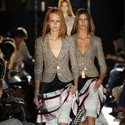 Clothing, Footwear, Leg, People, Human body, Shoulder, Joint, Human leg, Outerwear, Fashion show,