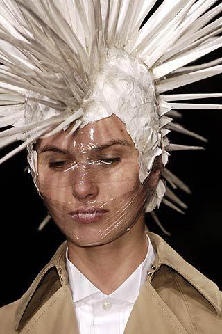 Hairstyle, Skin, Chin, Style, Headgear, Costume accessory, Fashion, Costume design, Beige, Fashion design,