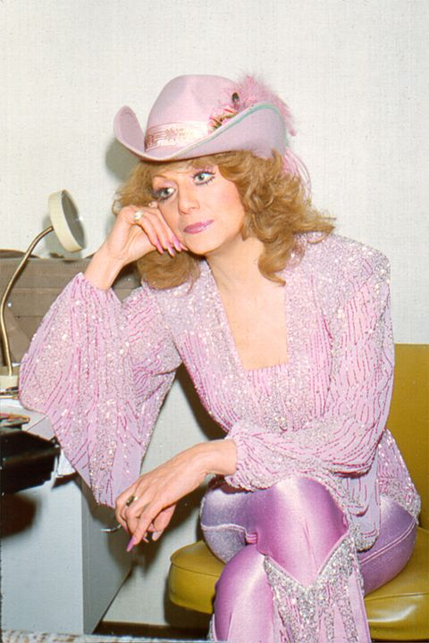 Hat, Pink, Fashion accessory, Sitting, Purple, Costume accessory, Headgear, Sun hat, Blond, Costume,