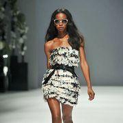 Clothing, Leg, Brown, Skin, Human leg, Dress, Human body, Shoulder, Fashion show, Joint,