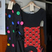 Sleeve, Collar, Textile, Clothes hanger, Fashion, Pattern, Jacket, Costume design, Fashion design, Button,