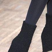 Human leg, Black, Costume accessory, Sock, Woolen, Ankle, Shadow, Wool, Foot, Woven fabric,
