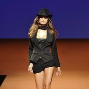 Clothing, Human body, Hat, Human leg, Fashion show, Joint, Style, Fashion model, Knee, Fashion accessory,