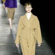 Clothing, Footwear, Leg, Coat, Sleeve, Standing, Joint, Collar, Outerwear, Formal wear,
