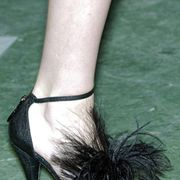 Joint, Human leg, Foot, Ankle, Basic pump, Close-up, High heels, Toe, Silver, Costume accessory,
