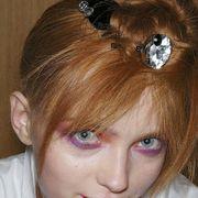 Lip, Brown, Hairstyle, Chin, Forehead, Eyebrow, Eyelash, Style, Hair accessory, Headgear,