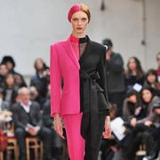 Lip, Fashion show, Shoulder, Runway, Joint, Outerwear, Red, Fashion model, Style, Flooring,