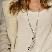 Clothing, Shoulder, Textile, Jewellery, Joint, White, Chest, Fashion accessory, Fashion, Body jewelry,