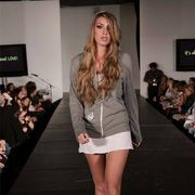 Face, Hairstyle, Fashion show, Event, Shoulder, Human leg, Runway, Joint, Outerwear, Fashion model,