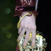 Wrist, Costume accessory, Fashion, Nail, Fur, Natural material, Costume hat, Body jewelry, Fashion design, Costume design,