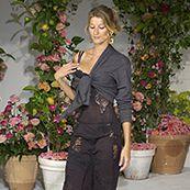 Clothing, Flowerpot, Human body, Joint, Flower, Fashion accessory, Formal wear, Interior design, Petal, Black,
