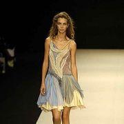 Clothing, Fashion show, Hairstyle, Shoulder, Human leg, Dress, Runway, Joint, Fashion model, One-piece garment,