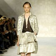 Clothing, Footwear, Leg, Fashion show, Brown, Shoulder, Human leg, Runway, Joint, Outerwear,
