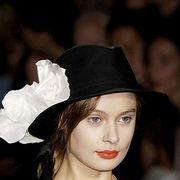 Lip, Hat, Formal wear, Headgear, Costume accessory, Fashion, Blazer, Costume hat, Costume, Sun hat,