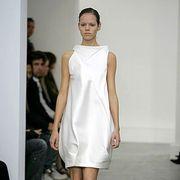 Clothing, Footwear, Shoulder, Dress, Human leg, Joint, White, Style, One-piece garment, Fashion show,