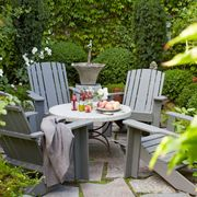 """Even if your outdoor area is on the small side, you can still (tastefully) fill it with furniture. Make the most of every inch with a stylish table and chairs that make entertaining a breeze—without making guests feel cramped.<a target=""""_blank"""" href=""""http://www.housebeautiful.com/room-decorating/outdoor-ideas/tips/g1383/easy-outdoor-decorating-ideas/?slide=5""""><em>From House Beautiful</em></a>"""