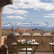 Cloud, Mountain range, Table, Furniture, Outdoor furniture, Outdoor table, Mountain, Cumulus, Summit, Ridge,