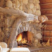 Wood, Room, Property, Interior design, Hearth, Wall, Sculpture, Living room, Carving, Hardwood,