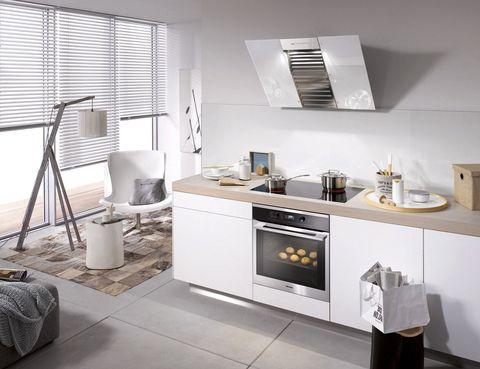 """<p>¿Te van las cocinas abiertas? Mira esta campana extractora de pared <i>DA 6096 W White Wing</i>, de Miele. Su visera de cristal <i>brilliant white</i> la convierte en todo un detalle decorativo. ¡Preciosísima! <a href=""""http://www.miele.es/electrodomesticos/index.htm"""" target=""""_blank"""">www.miele.es</a></p>"""