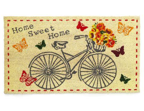<p>Felpudo con estampado de bici y mariposas (10 €), de <strong>BHS.</strong></p>