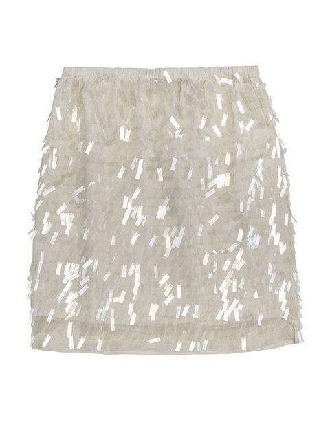 <p>Minifalda con pailletes blancas y transparentes de <strong>Zara.</strong></p>