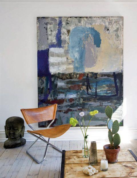 <p>El gran lienzo es obra del artista abstracto taiwanés Thaiwijit Puangkasemsomboon. El buda, de Bali, se puede comprar en Rabens Saloner.</p>