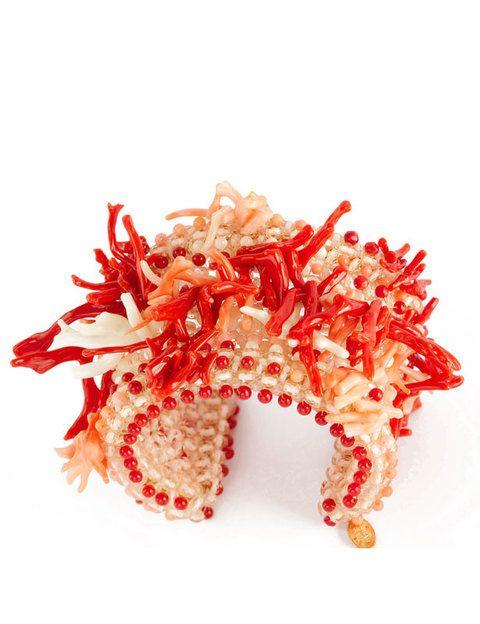 <p>Brazalete de coral natural y cristal. </p><p></p>