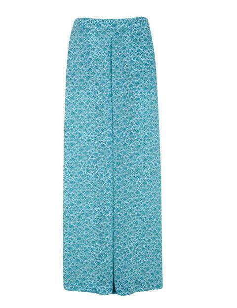 <p>Estos pantalones de <strong>Blanco</strong>, color aguamarina estampados, simulan a una falda larga. No nos decidimos al definirlos, ¿pijama pant o palazzo?</p>