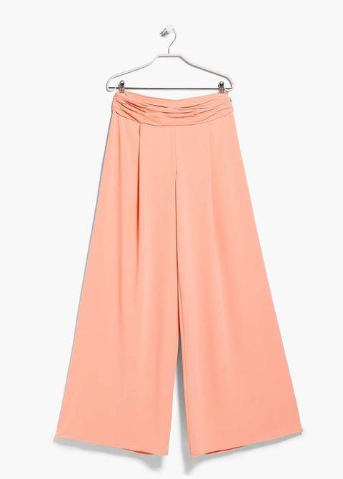 <p>Pantalones palazzo en tono melocotón de&nbsp;<strong>Mango,&nbsp;</strong>50 €.</p>