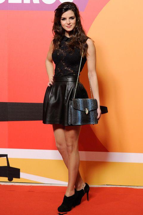 <p>En la premiere de <i>'Los amantes pasajeros'</i>, Clara escogió un top de encaje negro, minifalda de cuero y botines negros. Un look salvaje y sexy completado por la melena suelta con ondas.</p>
