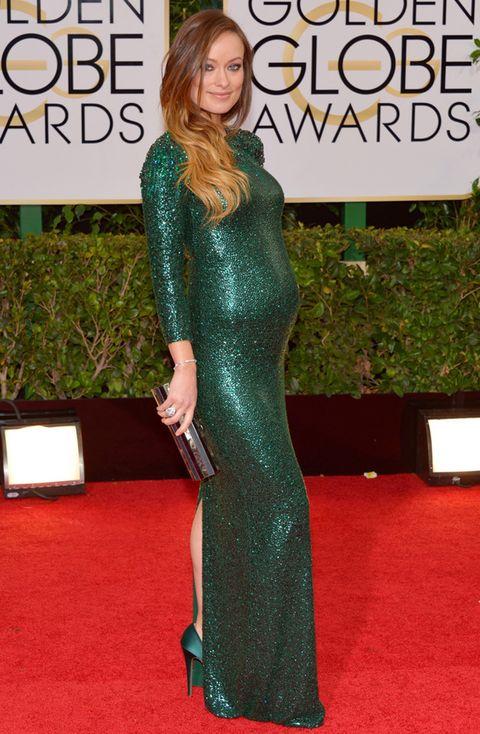 <p>Un look de alfombra roja nos gusta aún más si la celebrity está embarazada y luce tripita enfundada en un vestido&nbsp;espectacular&nbsp;. Es el caso de <strong>Olivia Wilde</strong> que estaba radiante en los Globos de Oro 2014 con este diseño verde con pailletes de <strong>Gucci&nbsp;Première</strong>. Como accesorios, clutch de&nbsp;<strong>Emm Kuo</strong>, salones verdes de&nbsp;<strong>Charlotte Olympia</strong> y joyas de&nbsp;<strong>Forevermark.</strong></p>