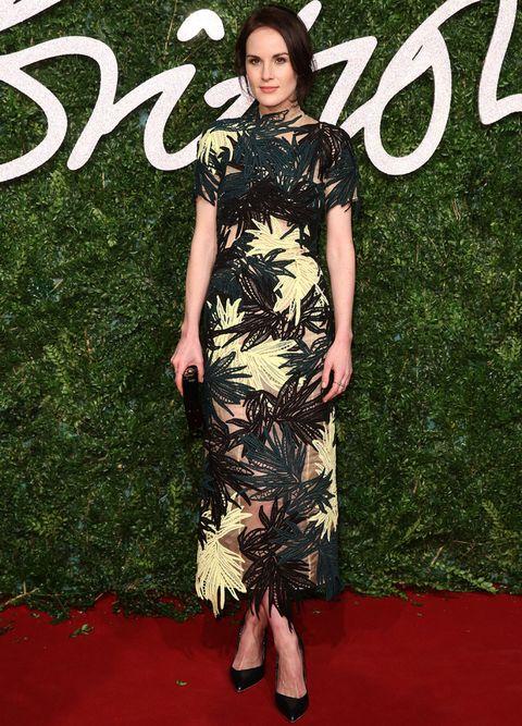 <p>En los British Fashion Awards 2014&nbsp;con un vestido midi de print tropical en verde, negro y amarillo de <strong>Erdem Primavera Verano 2015</strong>, más accesorios en negro. De 10.</p>