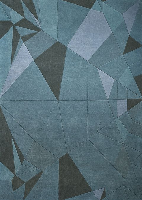 <p>Descubrimos los pliegues de este arte japonés en la alfombra Pingüino azul, de la colección Fusión de Nendo para la firma BoConcept. Oriente y occidente a tus pies. </p>