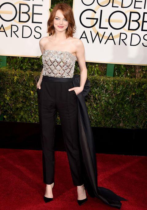 <p><strong>Emma Stone</strong> prescindió del clásico vestido y optó por este look con mono de cuerpo joya y pantalones negros con lazada lateral de <strong>Lanvin</strong> y salones de <strong>Christian Louboutin </strong>para asistir a la gala de los Globos de Oro 2015. Su atrevida apuesta tiene premio y se ha convertido en la mejor de la semana.&nbsp;</p>