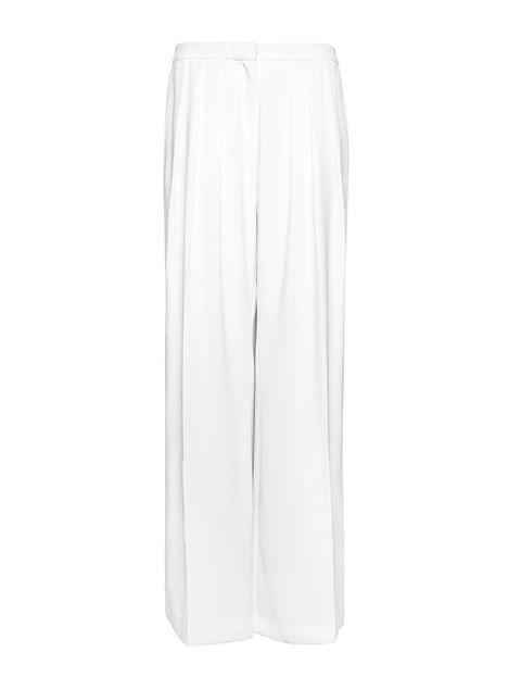 <p>Pantalones anchos blancos (24'95€) de <strong>Mango.</strong></p>