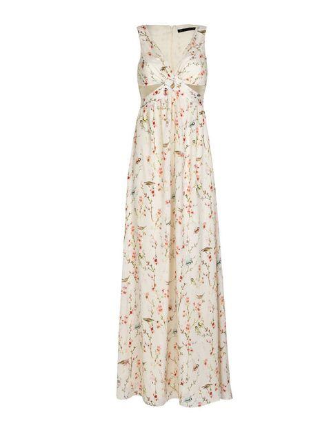<p>Vestidod e flores con aberturas, <strong>de Zara por 49,95 €.</strong></p>