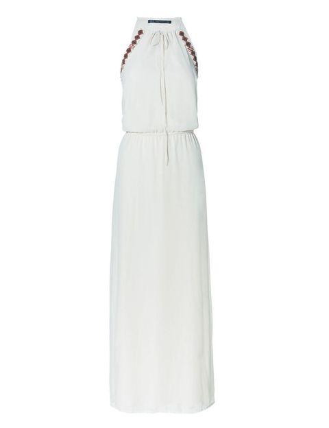 <p>Vestido blanco de escote halter con ribete étnico, <strong>de Zara, 39,95 €.</strong></p>