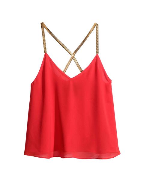 <p>Top rojo con tirantes dorados, de <strong>H&M</strong> 19,99 €.</p>