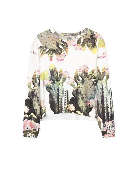 <p>Sudadera con cactus y flores <strong>de Zara.</strong></p>