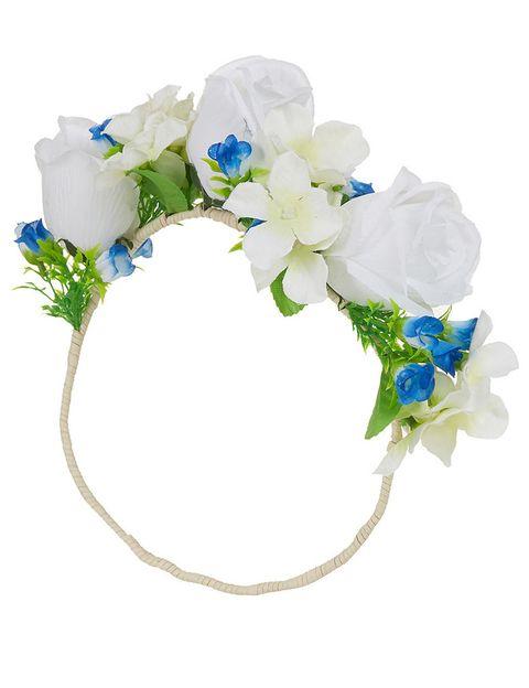 <p>Diadema de flores (26 €), de <strong>Topshop</strong>. </p><p>&nbsp;</p>