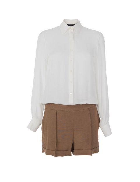 <p>Vestido bicolor en blanco y beis de<strong> Zara.</strong></p>