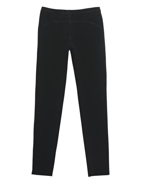 "<p>Pantalones negros tipo malla de <a href=""http://www.lacoste.com/esp/"" title=""Lacoste"" target=""_blank"">Lacoste</a>.</p>"