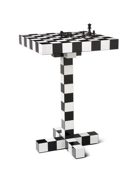 <p>La mesa Chess para Moooi da juego... ¿apetece una partida?</p>