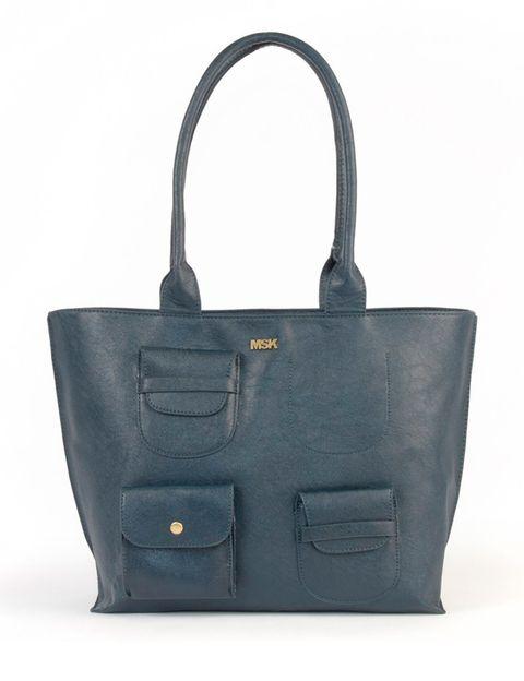 <p>Con bolsillos de varios tamaños en la parte frontal (27,99 €).</p>