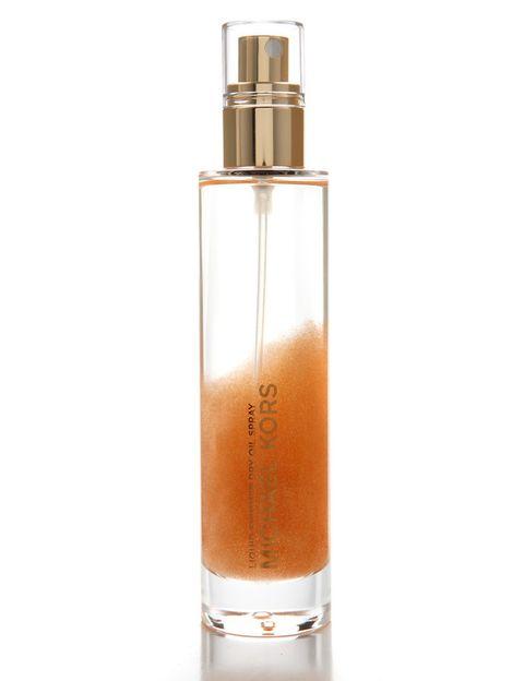 <p>Consigue un toque satinado en la piel con 'Liquid Shimmer Dry' (54 €), un aceite hidratante con partículas de brillo. De <strong>Michael Kors.</strong></p>
