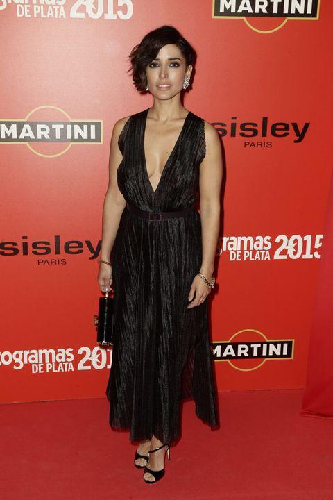 <p><strong>Inma Cuesta</strong> muy sensual con un look en negro con vestido midi de <strong>Boss</strong>.</p>
